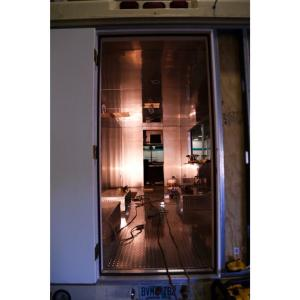 A view from the backdoor of a food truck, stainless