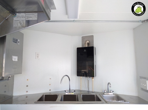 A three-compartment sink, a hand sink, and a water heater.